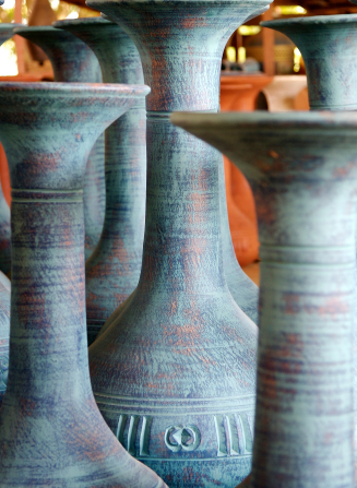 Tall blue and gray ceramic pots in a market in Ghana.