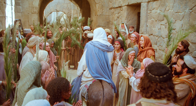 Matthew 21:1–11, Jesus walks among the crowds that greet Him
