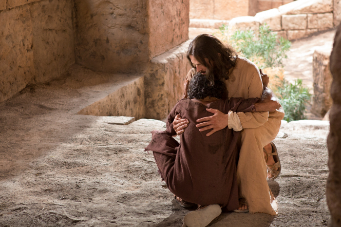 John 9:1–41, A previously blind man hugging Christ after he is healed