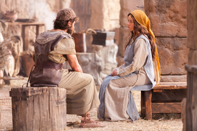 Mary sitting and talking with Joseph