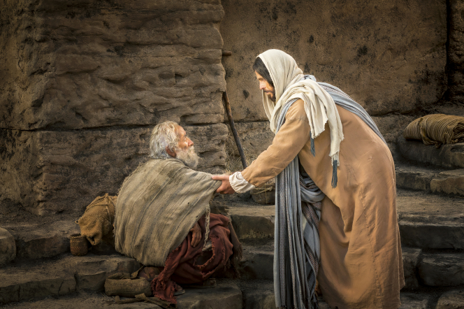 An elderly man sitting down by the pool of Bethesda while Christ stretches out His hand to heal him.