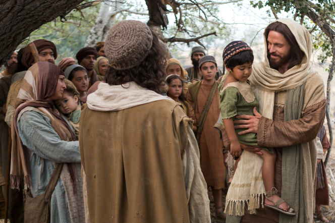 Luke 18:15–17, Jesus carries a little child