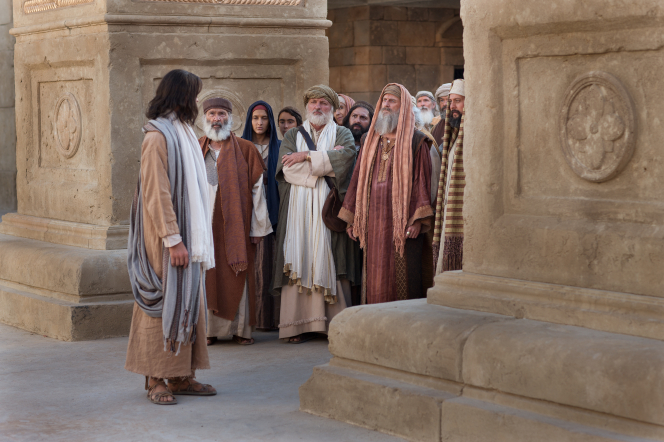 John 8:12–58, Jesus stands in the temple and speaks with the Pharisees