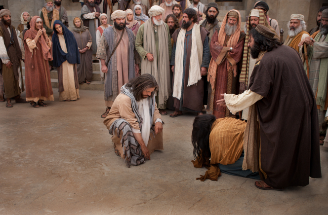 John 8:2–11, Christ writes in the sand in front of the woman caught in adultery