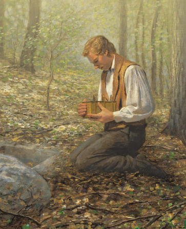 Joseph Smith kneeling and holding the golden plates.