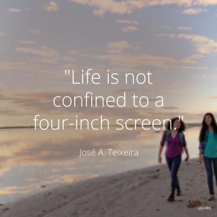 "An image of two girls walking along a lakeside, combined with a quote by Elder José A. Teixeira: ""Life is not confined to a four-inch screen."""