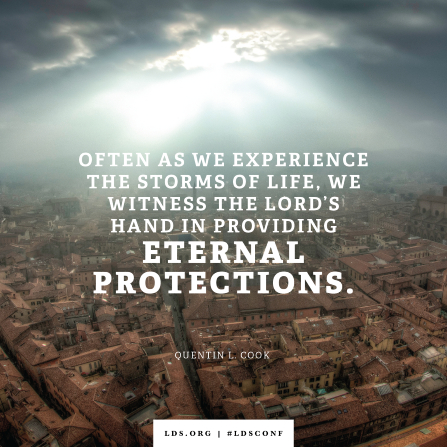 "An image of a city combined with a quote by Elder Cook: ""We witness the Lord's hand in providing eternal protections."""