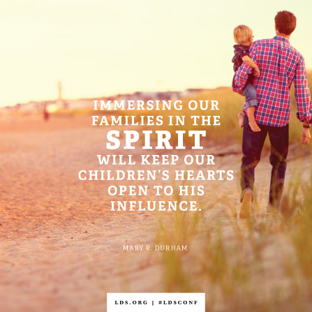 "An image of a father and child combined with a quote by Sister Durham: ""Immersing our families in the Spirit will keep our children's hearts open to His influence."""