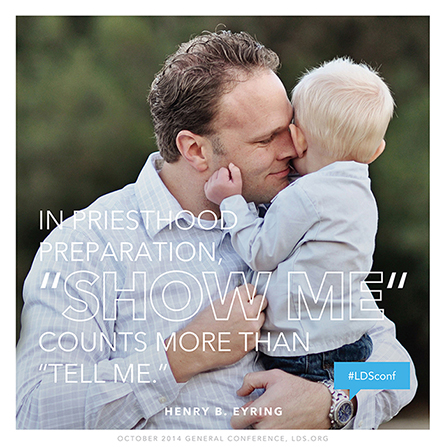 "An image of a father holding his son, paired with a quote by President Henry B. Eyring: ""'Show me' counts more than 'tell me.'"""