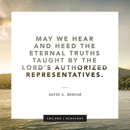 "A quote by Elder David A. Bednar beginning with ""May we hear and heed"" on a white background bordered by a lake and mountains."