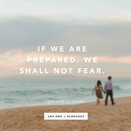 "A photograph of a couple holding hands and walking on the beach, with a quote from Elder Quentin L. Cook: ""We shall not fear."""