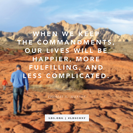 "A photograph of a man and a young boy hiking on red rocks, with a quote from President Thomas S. Monson: ""Keep the commandments."""