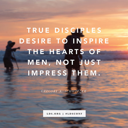 "A photograph of two people standing in water at sunset, with words from Elder Gregory A. Schwitzer: ""True disciples desire to inspire the hearts of men."""
