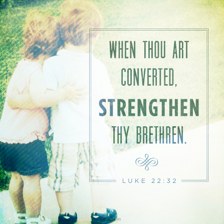 A photograph of two children hugging, paired with the words from Luke 22:32.
