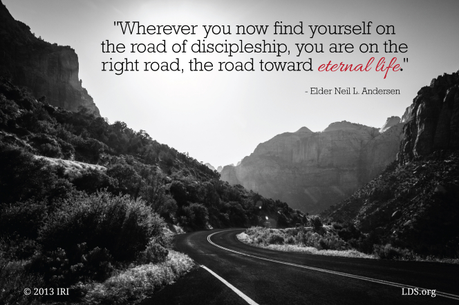 "A black-and-white image of a road passing through mountains, with a quote by Elder Neil L. Andersen on top: ""The road of discipleship."""