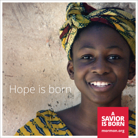 """A close-up image a girl wearing a yellow head wrap, paired with the words """"Hope is born."""""""