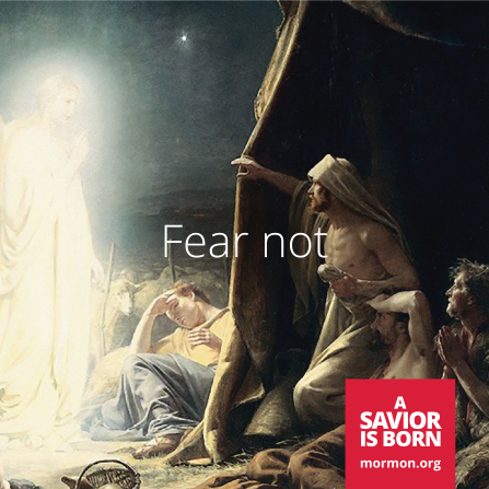 "A painting of an angel appearing to shepherds, with the words ""Fear not"" in the center."