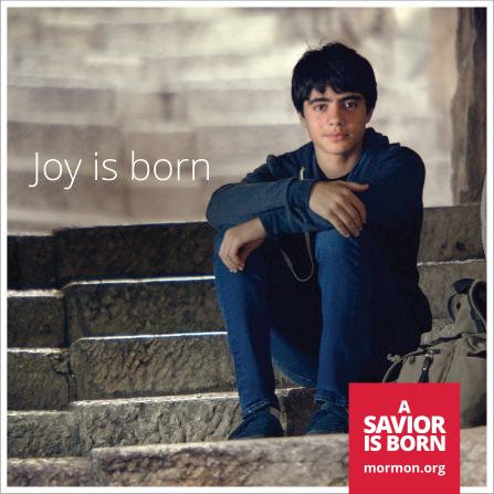 """A photograph of a young man sitting on steps with his backpack beside him, paired with the words """"Joy is born."""""""