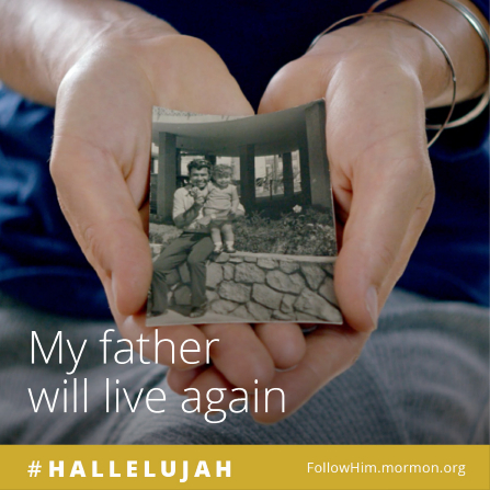 "A woman holding a black-and-white photograph of herself and her father, paired with the words ""My father will live again."""