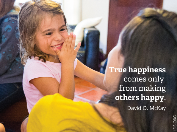 "A photograph of a young girl laughing, paired with a quote by President David O. McKay: ""True happiness comes only from making others happy."""