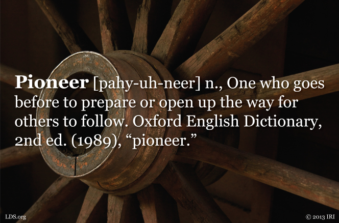 An image of a wagon wheel with the definition of the word pioneer printed over the top.