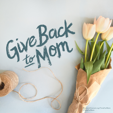 "A photograph of some fresh tulips wrapped in brown paper, paired with the words ""Give back to Mom."""
