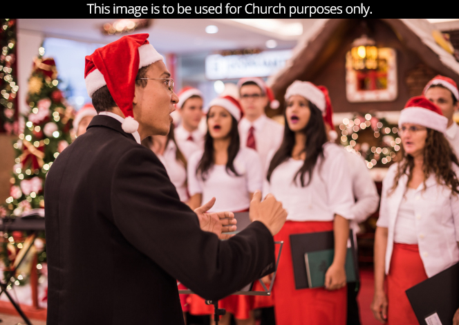 A youth choir giving a public performance at Christmastime.