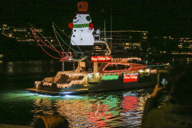 A festive, illuminated boat sails in the Newport Beach Boat Parade in California.