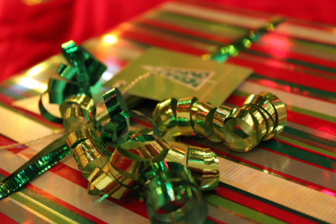 A photograph of a green ribbon on a Christmas present.
