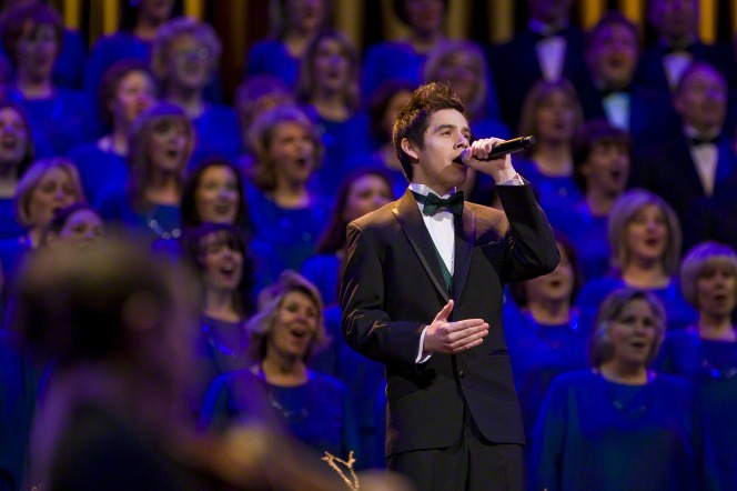 The singer David Archuleta stands and performs with the Mormon Tabernacle Choir during Christmas.