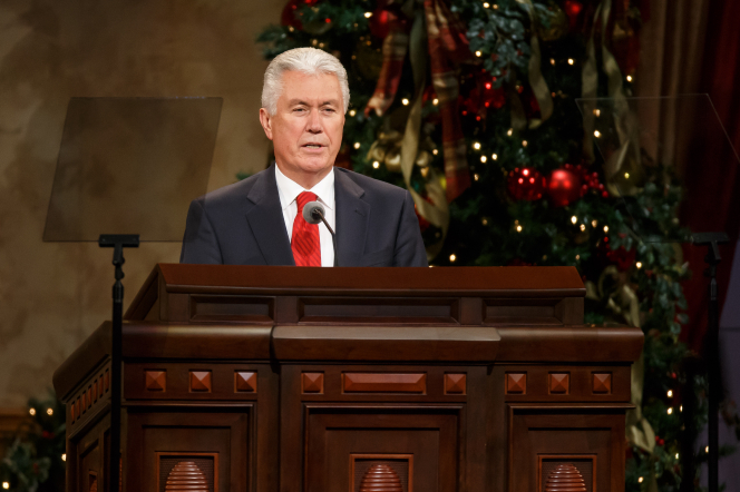 President Uchtdorf giving a talk in the Conference Center during a First Presidency Christmas Devotional.