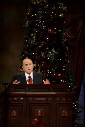 President Monson giving a talk in the Conference Center during a First Presidency Christmas Devotional.