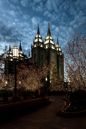 A photograph of the Salt Lake Temple at night during Christmastime.