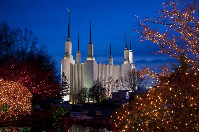 The Washington D.C. Temple and grounds covered in lights during the Christmas season.