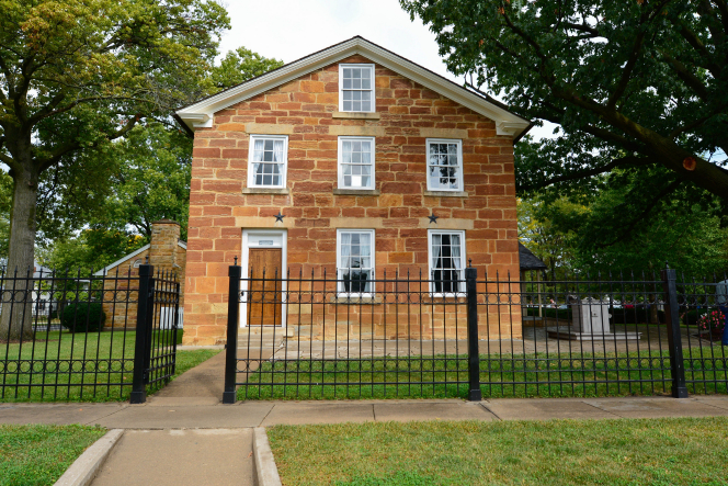 A front view of Carthage Jail, a brick building in Illinois, where Joseph and Hyrum Smith were martyred.