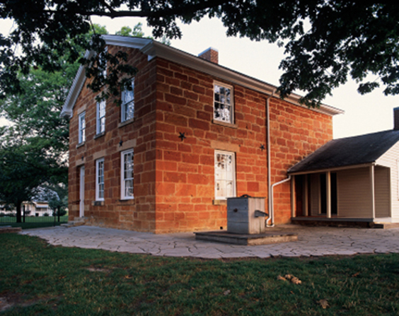 A picture of Carthage Jail, a two-floor brick building.
