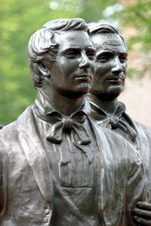 A front view of the faces of Joseph and Hyrum Smith on the statue that stands at Carthage Jail.