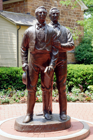 A metal statue of brothers Hyrum and Joseph Smith stands in Carthage, Illinois, near Carthage Jail.
