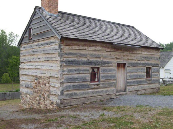A photo of the wooden Smith family cabin.