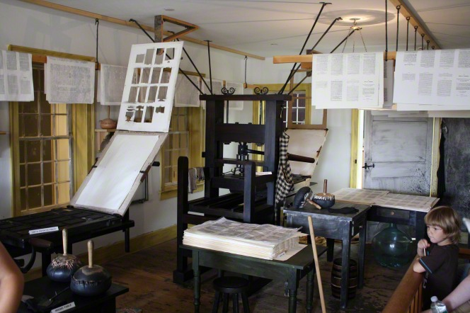 A room full of printing press equipment and papers in Palmyra, New York.