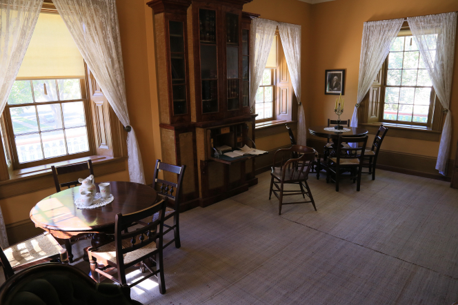 A large room with two tables surrounded by chairs inside the lower level of the Brigham Young winter home in St. George, Utah.