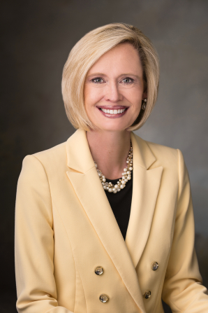 A formal portrait of Bonnie H. Cordon wearing a pale yellow blazer.