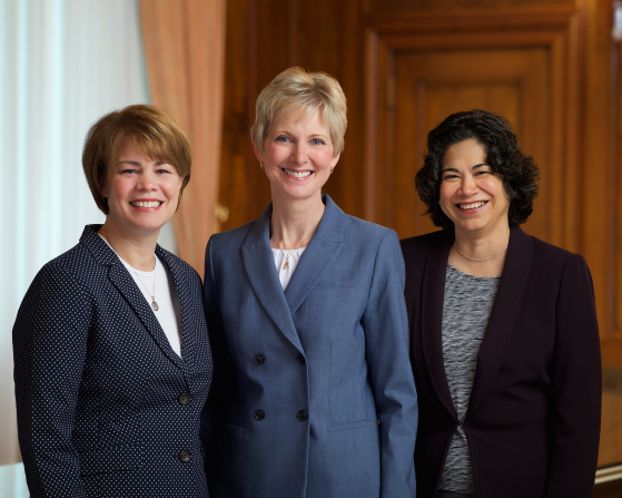 A formal group portrait of Sharon Eubank, Jean B. Bingham, and Reyna I. Aburto.