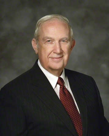A portrait of Elder Richard G. Scott, who is wearing a black pinstriped suit and a red tie, in front of a gray background.