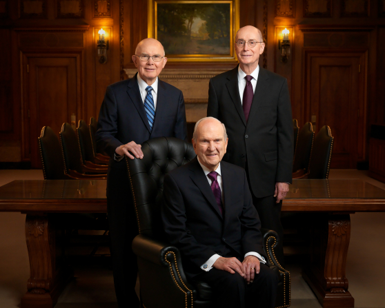 A portrait of the First Presidency, with President Russell M. Nelson seated in a chair and President Dallin H. Oaks and President Henry B. Eyring standing behind him.
