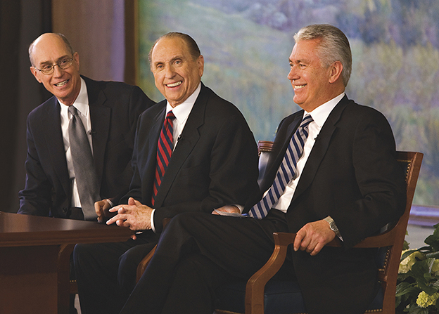 An informal portrait of President Thomas S. Monson, President Dieter F. Uchtdorf, and President Henry B. Eyring wearing suits and ties and smiling.