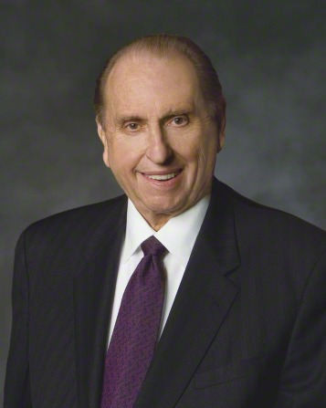 A formal portrait of President Thomas S. Monson, who is wearing a black suit and a purple tie, in front of a blue background.