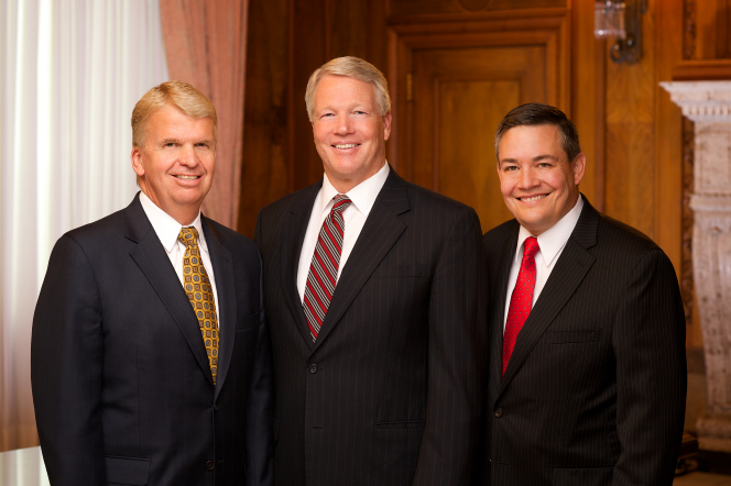 A portrait of the general Young Men presidency standing together in a row in front of a wooden wall and a curtained window.