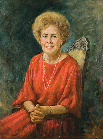 A painted portrait of Naomi Maxfield Shumway sitting in an upholstered chair against a blue background, wearing a red dress and pearls.