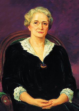 A painted portrait by Lee Greene Richards of Amy Brown Lyman against a purple background, sitting in a wooden chair with green upholstery. She is wearing a black dress trimmed in white lace.